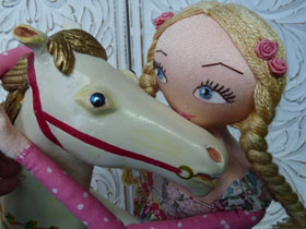 A doll with toy horse
